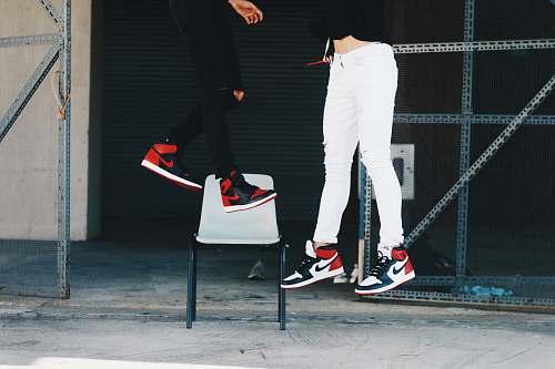 human two people wearing Air Jordan shoes jumping person