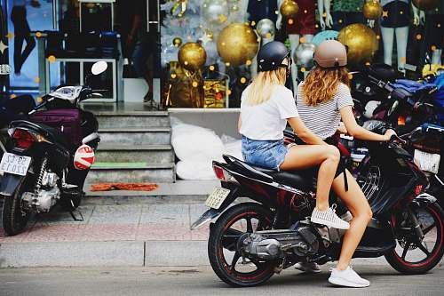 motorcycle two women riding motorcycle transportation
