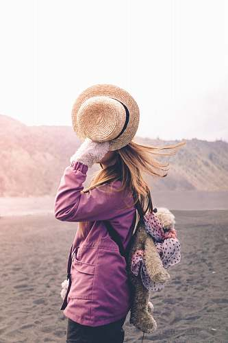human woman holding his brown hat person