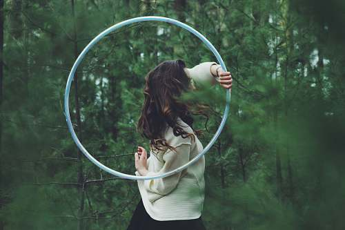 human woman holding hulahoop person