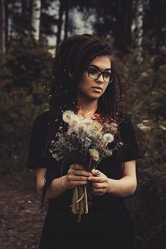 human woman holding white flowers person