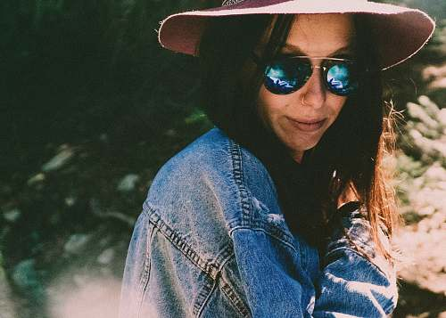 human woman in denim jacket wearing shades person