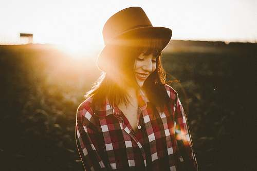 girl woman in white and red checkered dress shirt hat