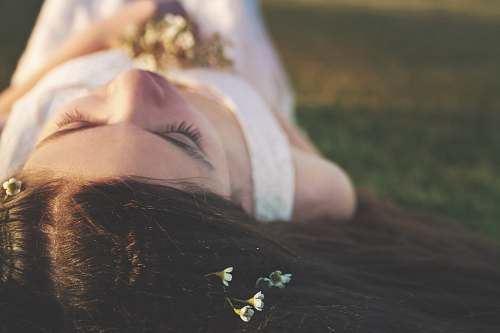 human woman lying on grass person