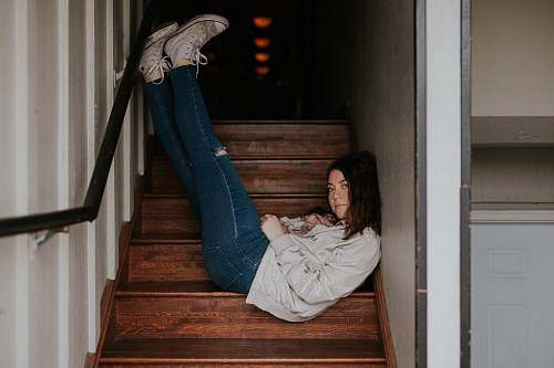 human woman lying on stairs person