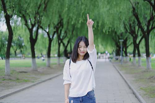 human woman raising her right arm person