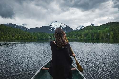 human woman riding boat sailing person