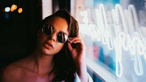 human woman sitting beside the glass window glasses