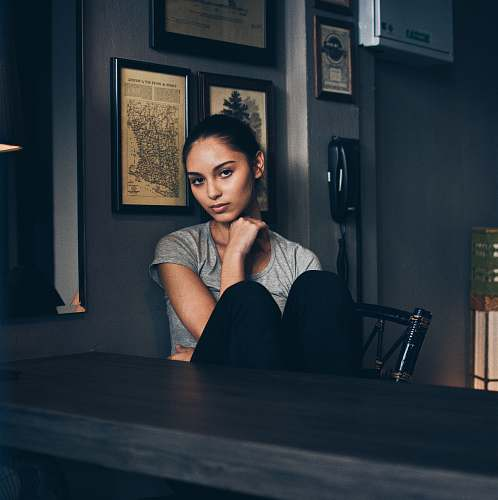 human woman sitting on chair infront of empty table person