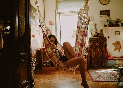 human woman sitting on hammock person