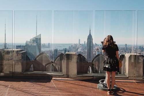 human woman standing near glass wall person