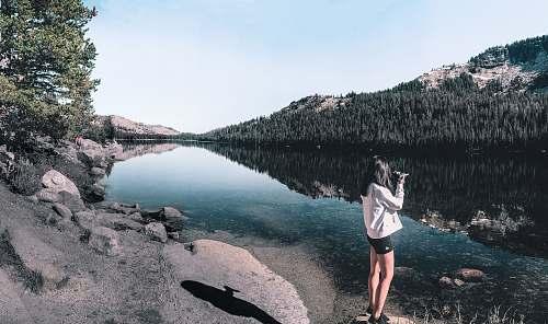 human woman standing near river person