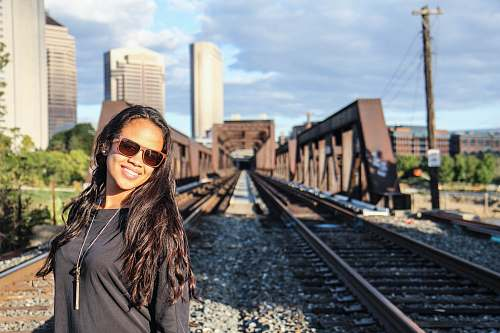 train woman standing on railings human
