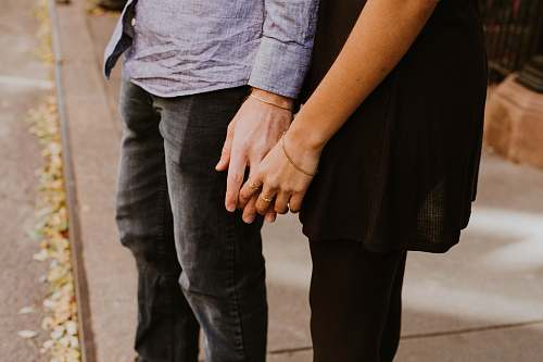 couple woman touching man's hand holding hands