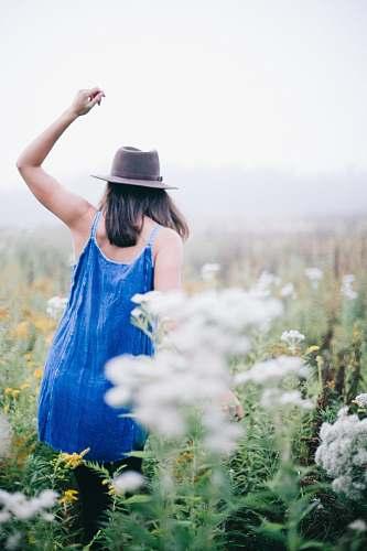 girl woman walking a flower field woman