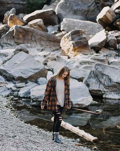 human woman walking beside body of water person