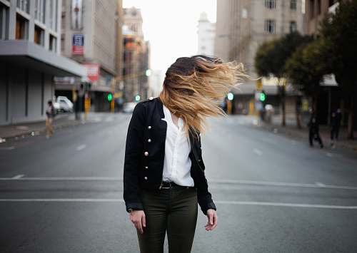 person woman waving hair by the wind on road human