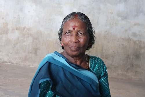 human woman wearing blue and teal polka-dot sari dress person