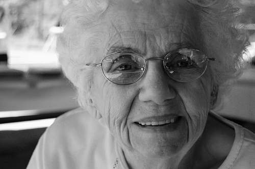 black-and-white woman wearing eyeglasses portrait