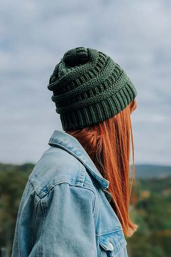 hat woman wearing green knit cap and blue denim jacket human