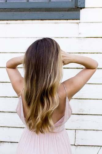 person woman wearing pink spaghetti strap dress hair