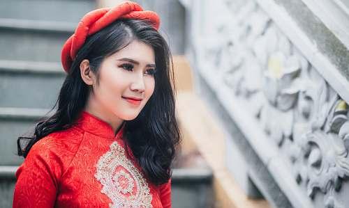 human woman wearing red cheongsam top near stair person