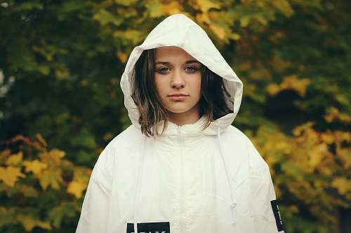 human woman wearing white zip-up hoodie jacket person