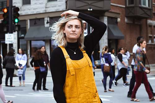 human women's yellow overall person