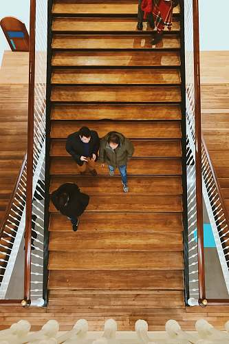 people aerial photography of person walking on stair human