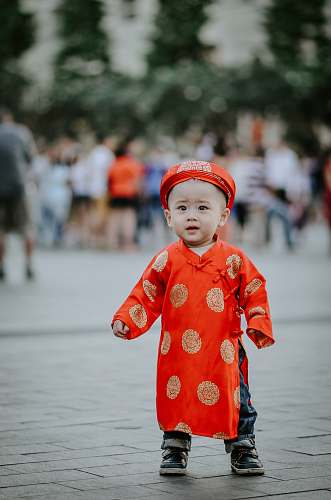 people baby's orange dress human