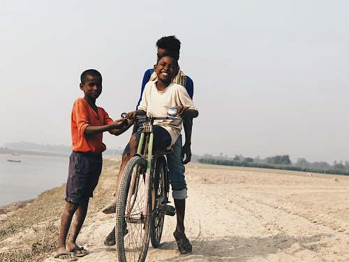 photo people boy riding on bike human free for commercial use images