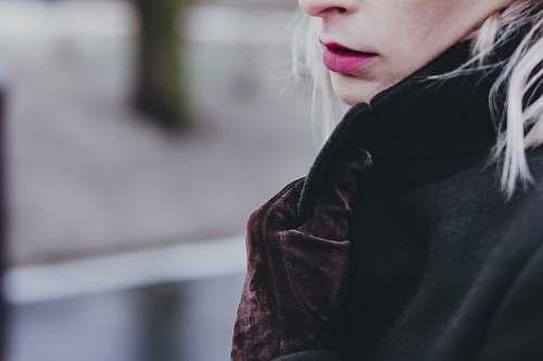 people closeup photo of woman wearing black and brown top human