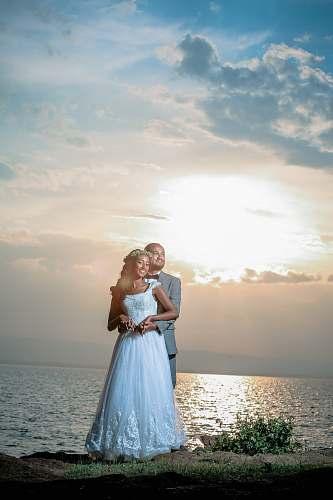 people couple's pre-nuptial photo near sea human