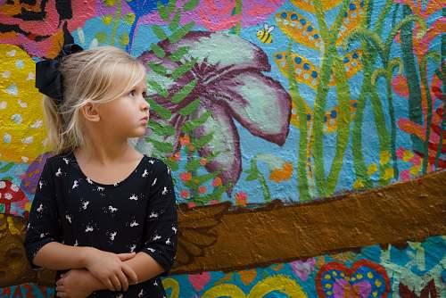 people girl leaning on floral wall human