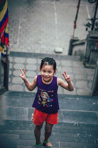 human girl showing peace sign people
