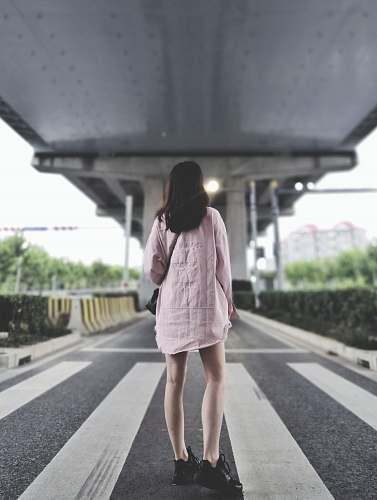 people girl standing on pedestrian lane during daytime human