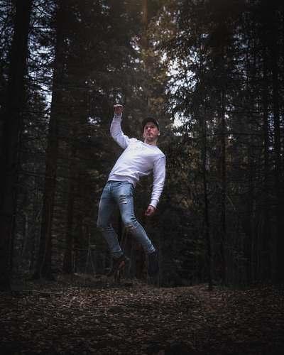human man between trees people