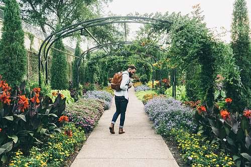 people man carrying backpack walking on garden nashville