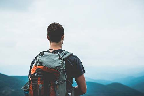 backpack man carrying hiking bag outdoors mountains