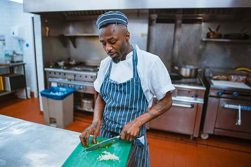 people man chopping garlic gloves human