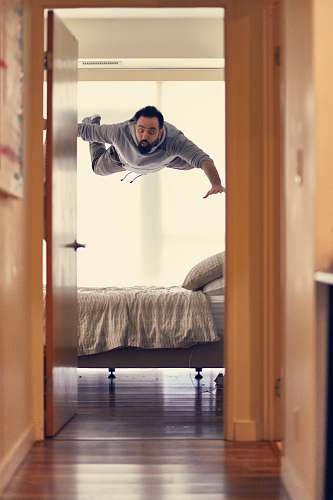 people man falling from ceiling on bed human