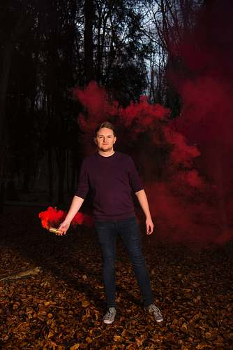 human man holding red smoke people