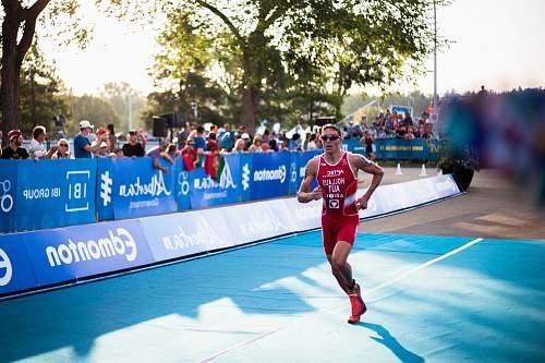 people man in red tank top running human