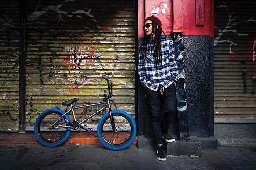 people man leaning on wall bike