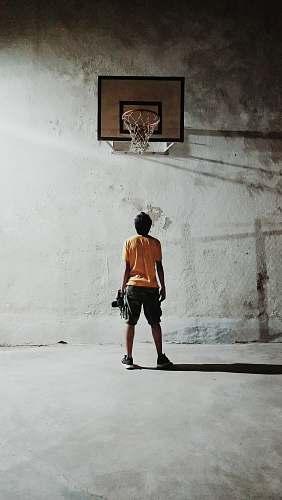 human man looking basketball ring people