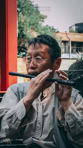 people man playing black flute human