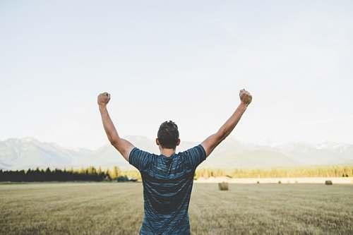 people man reaching hands up high taken at daytime human