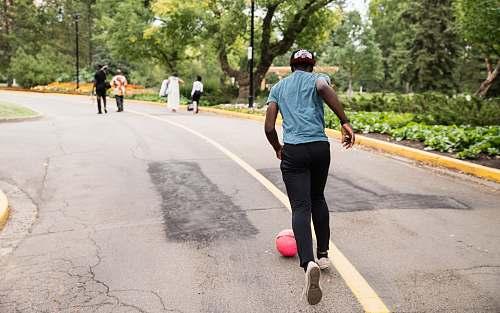 people man running behind red ball human