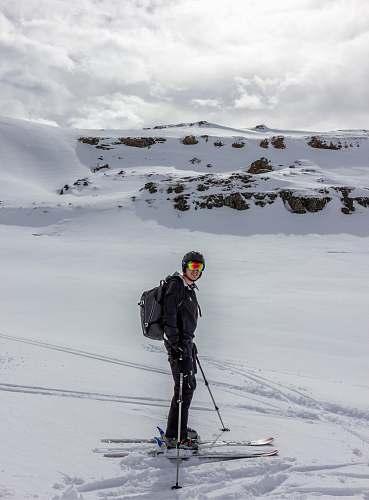 human man skiing on mountain people