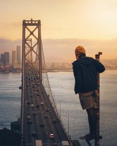 human man standing looking bridge people